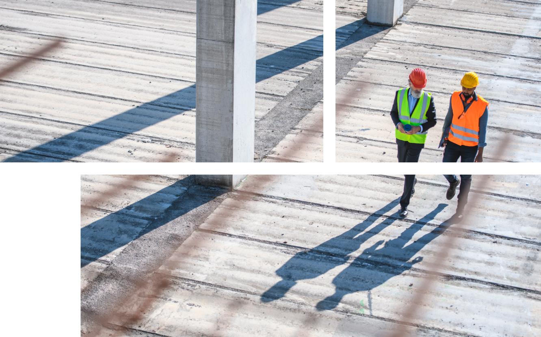 Workers walking on job site.